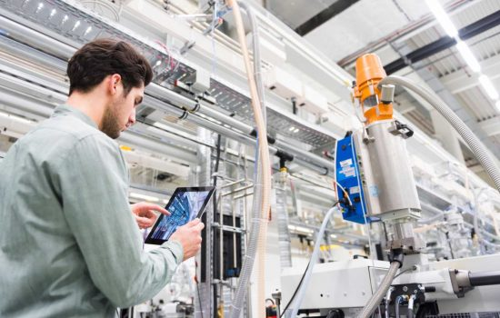A tool manufacturing floor manager analyses smart factory equipment using the Internet of Things (IoT) - image courtesy of Cisco.