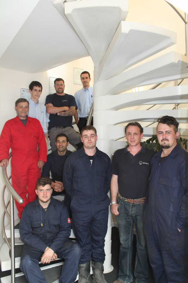 Apprentices at Spiral UK Ltd alongside one of their products