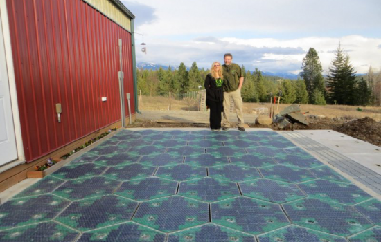 The completed parking lot prototype for the Solar Roadways project with company founders Julie and Scott Brusaw - image courtesy of Wikicommons and Dan Walden