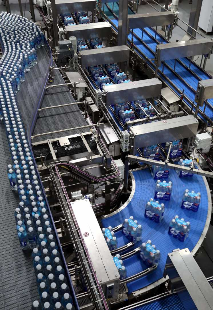 The new high speed, fully-automated Glacéau SmartWater processing and bottling line is capable of producing more than 56,000 bottles an hour - image courtesy of CCEP.