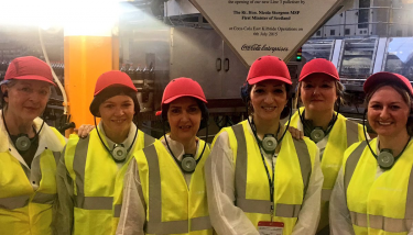 Dr Lisa Cameron MP and Tasmina Ahmed-Sheikh MP on site at CCEP's East Kilbride factory - image courtesy of CCEP.