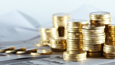 Working Capital Tax Relief Manufacturing Jobs Economy Piles of Coins on Notes UK MAnufacturing - Shutterstock - Finance Investment - Autumn Statement
