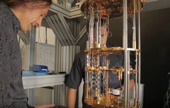 UNSW researchers inspect their quantum computing device. Image courtesy of UNSW.