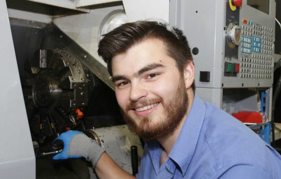 Advanced Structural Testing Centre machinist, Edward Allen, with the newly-refurbished CNC machine - image courtesy of AMRC.