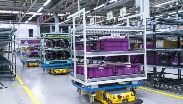 Self-driving 'Smart Transport Robots' (STR) are already transporting components through logistics at BMW's Bavarian Innovation Park – image courtesy of BMW Group.