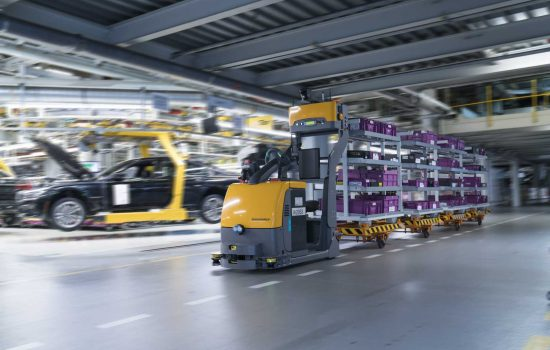 Self-navigating tugger trains are being piloted to narrow the gap between individual warehouses and assembly areas – image courtesy of BMW Group.