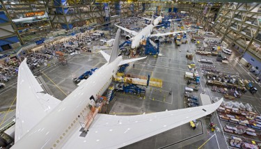Over the course of 100 years, Boeing has gone from handcrafting small canvas and wooden wings for biplanes to producing the high-tech carbon–fibre composite wings of the 787 Dreamliner - image courtesy of Boeing.