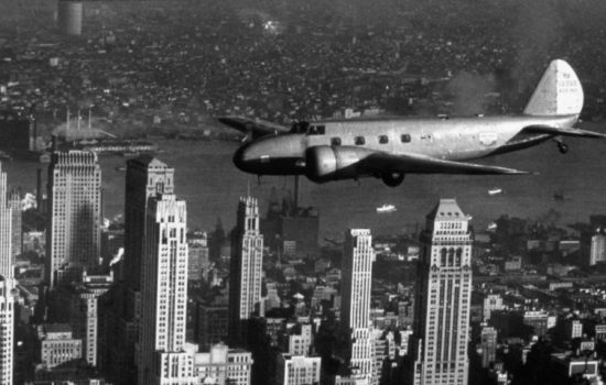 A Boeing Model 247D flies over New York. Introduced in the 1930s, the all-metal, twin-engine aircraft is considered the first modern passenger plane - image courtesy of Boeing.