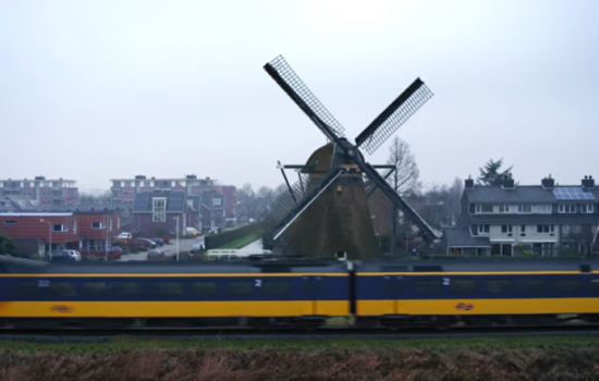 NS Dutch Railways CEO, Roger van Boxtel, recently strapped himself to a windmill blade to celebrate every Dutch electric train running on wind power - image courtesy of NS Dutch Railways.
