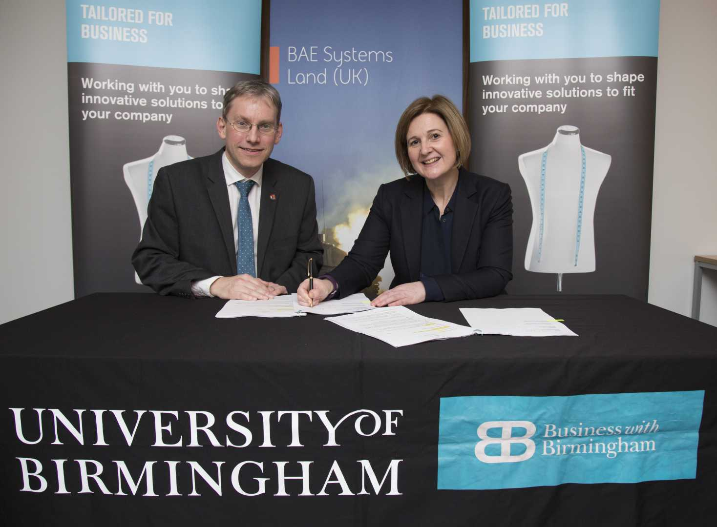 Professor Andy Schofield, University of Birmingham, and Jennifer Osbaldestin, BAE Systems managing director, Land.