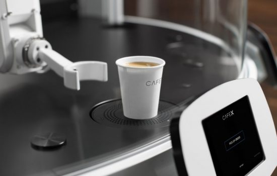 A Cafe X robotic arms serves up a cup of coffee. Image courtesy of Cafe X.