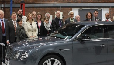 Lord Baker with staff and pupils at the Crewe UTC, admiring a Flying Spur made by Bentley, one of the local companies supporting the UTC.