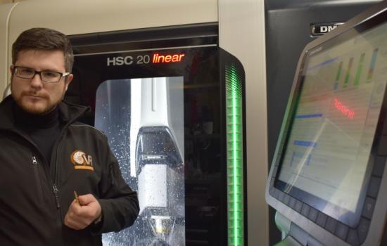 CEO Olly Dmitriev alongside the DMG-Mori produced HSC-20 linear machine - image courtesy of Vert Rotors.