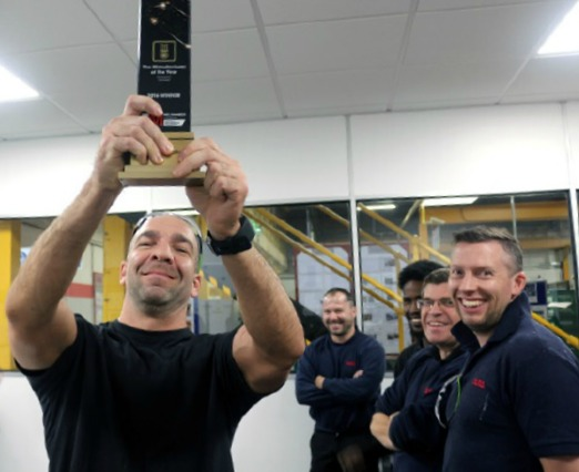 Dura Automotive has proudly emblazoned its achievements on staff uniforms and lanyards, and even commissioned a giant banner to adorn the factory.