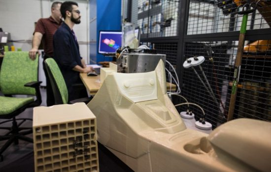 Ford workers print car parts using a Stratasys 3D printer. Image courtesy of Ford Motor Company