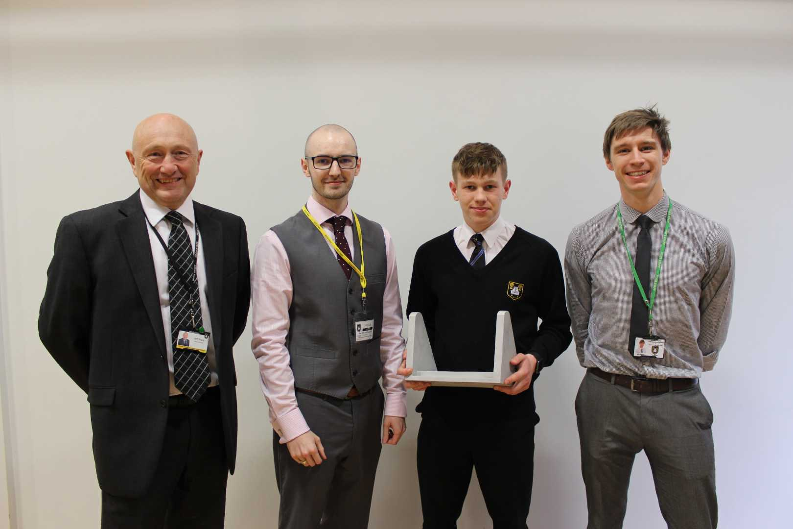L to R: Jeff Sharp (Head of School at Holmes Chapel Comprehensive School), Matt McGillicuddy (PI Castings), Sam Wooler (GCSE Student) & Aron Rutter (Lead of Design and Technology at Holmes Chapel Comprehensive School) – image courtesy of PI Castings.