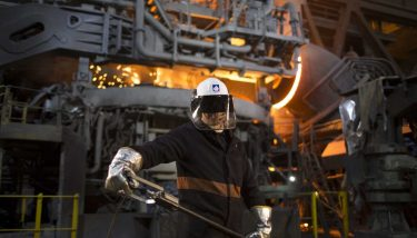 Greensteel - Liberty worker in front of Electric Arc Furnace - image courtesy of Liberty House.