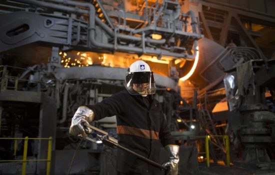 Liberty worker in front of Electric Arc Furnace - image courtesy of Liberty House.