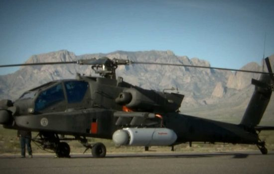 An Apache attack helicopter was outfitted with a laser weapon pod. Image courtesy of Raytheon.