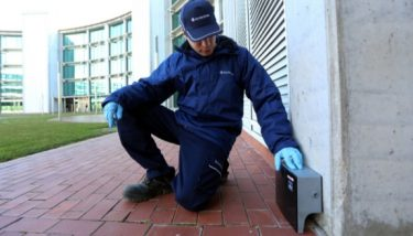 Anticimex service technician servicing a digital trap.