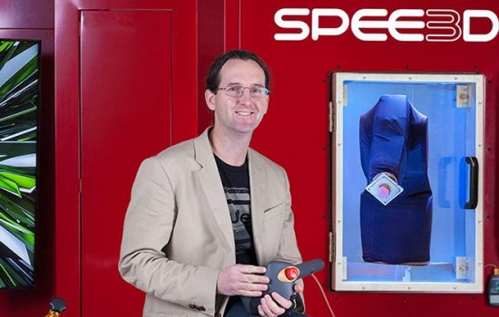 SPEE3D CEO Byron Kennedy and his LightSPEE3D metal printer - image courtesy of business.gov.au