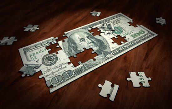 Puzzle money finance cash bank notes investment funding – image courtesy of Pixabay.
