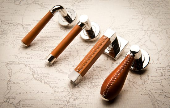 Tan leather door handles by Turnstyle Designs - image courtesy of Turnstyle Designs.
