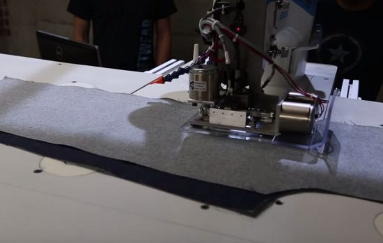 A Sewbot robot autonomously sews a pair of jeans. Image courtesy of SoftWear Automation.