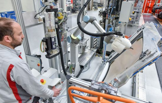 Human-robot cooperation: KLARA facilitates greater diversity of versions in production at Audi - image courtesy of Audi