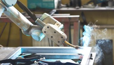 Cobots - The UR5 collaborative robot was reportedly cheaper than buying a new, dedicated welding robot.- image courtesy of Universal Robots.
