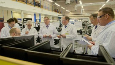 Meggitt CEO, Stephen Young (third from right) on the shop floor – image courtesy of Meggitt.