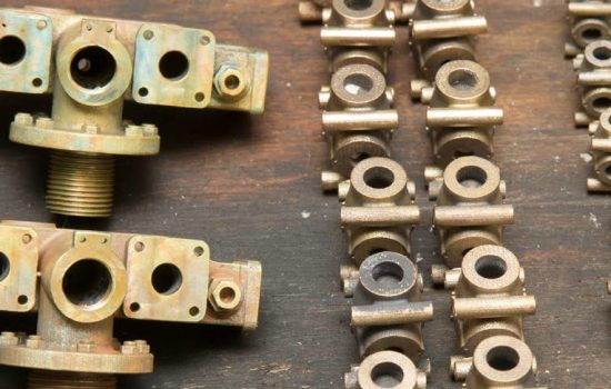 A miniature production line of bronze manifolds and globe valve bodies.