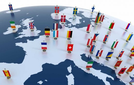 Europe European continent marked with flags - image courtesy of Depositphotos.
