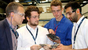 Andrew Churchill (L) with apprentices - image courtesy of JJ Churchill.