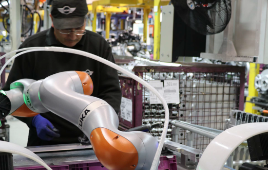 Cobot - RITA on the MINI Plant Oxford production line, helping to assemble components for the car's crumple zone pre-assembly - image courtesy of BMW Group MINI.