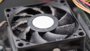Dusty dirty processor PC fan - image courtesy of Depositphotos.