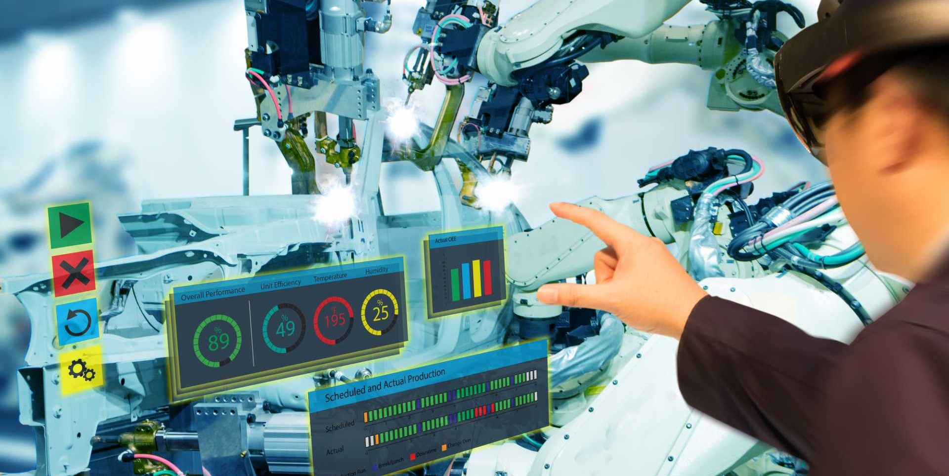 4IR Iot industry 4.0 concept,industrial engineer using smart glasses with augmented mixed with virtual reality technology to monitoring machine in real time.Smart factory use Automation robot arm– image courtesy of Depositphotos.
