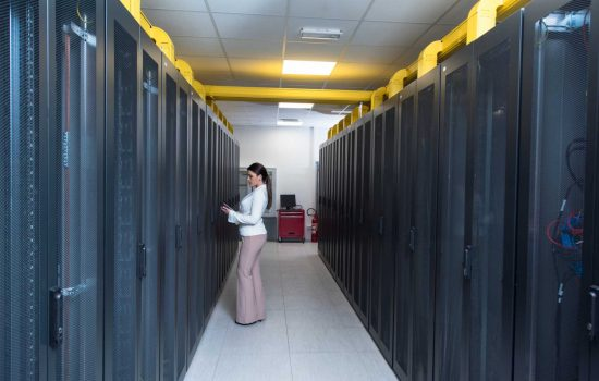 Female engineer working on a tablet computer in server room– image courtesy of Depositphotos.