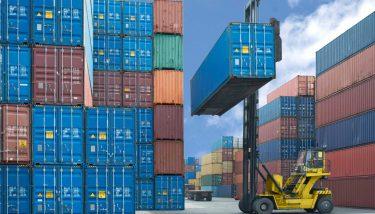 Forklift handling container box loading to truck in import export - image courtesy of Depositphotos.