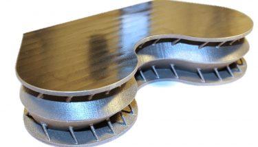 ATOS 3DP titanium spacecraft insert with post-printing machine surface.