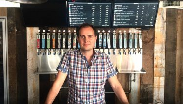 Dan Lowe is pictured in the tap room selling Fourpure's popular craft beer, which is open to the public every day from noon.