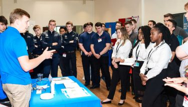 Home Automation Challenge 2018 - Every team had to present to their peers. Here, Leonardo Airborne & Space Systems' Jonah Quinton demonstrates M.A.D.D.Y., The Pilgrims' 3D printed, automatic pill dispenser - image courtesy of The Manufacturer's staff photographer Calum McCarron.