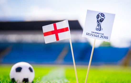 CROP - England national flag and Official logo of Football FIFA World Cup 2018 in Russia - image courtesy of kovop58 / Shutterstock.com.
