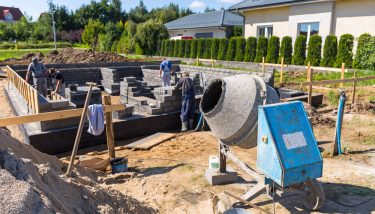 Cement mixer for building house foundation - image courtesy of Depositphotos.