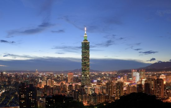 Panoramic city skyline in night with famous 101 skyscraper and buildings in Taipei, Taiwan - image courtesy of Depositphotos.