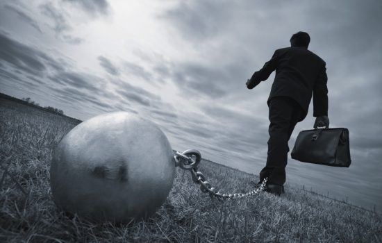 Businessman With Ball And Chain - Debt Finance - image courtesy of Depositphotos.
