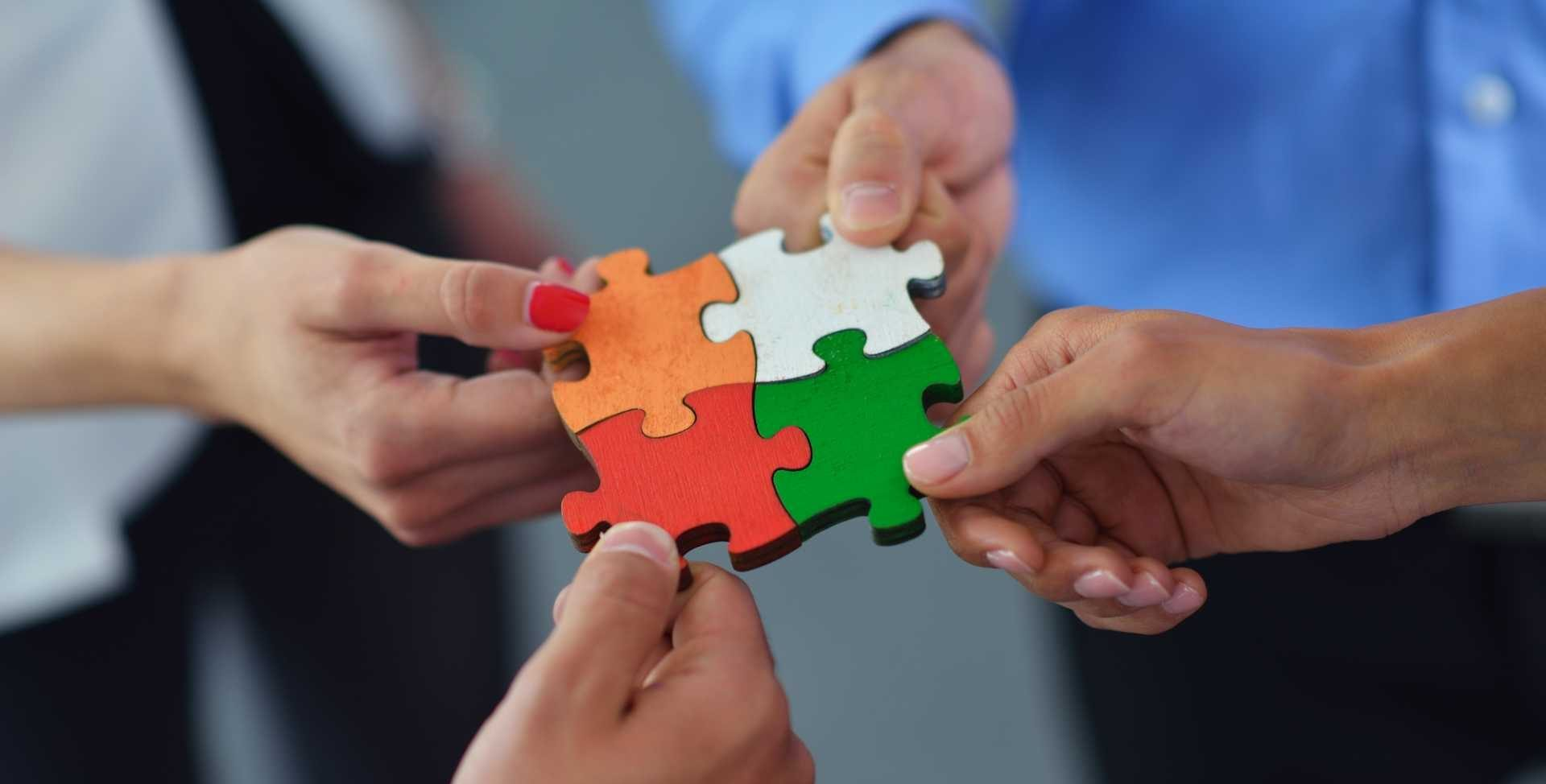 Group of business people assembling jigsaw puzzle - What support are UK manufacturers asking for - image courtesy of Depositphotos.