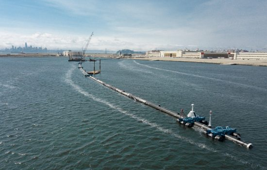 The Ocean Cleanup System 001 floating in the lagoon in front of the assesmbly yard - image courtesy of The Ocean Cleanup.