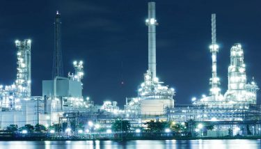 Oil refinery factory - image courtesy of Depositphotos.