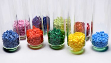 Dyed polymer in test glasses - image courtesy of Depositphotos